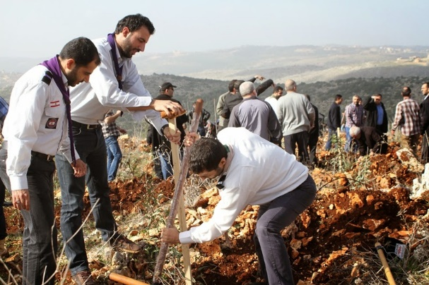 Imam al-Mahdi Scout leaders plant a tree at a Green Without Borders event in the village of Haddatha in south Lebanon (Green Without Borders website, February 12, 2015).