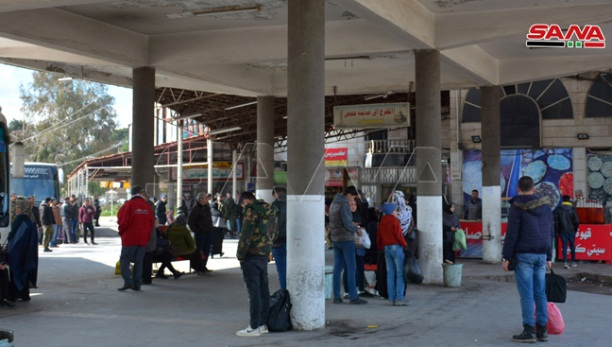 Civilians waiting near the bus platform to Homs, which resumed operation (SANA, February 23, 2020)