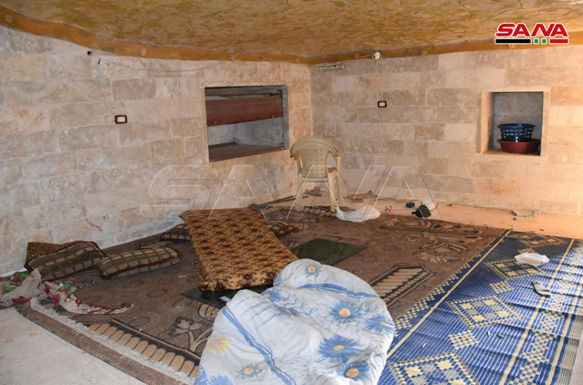 Underground space which apparently had been used by rebel operatives as sleeping quarters in Tillat al-Nar, southwest of Maarat Nu'man (SANA, February 25, 2020)