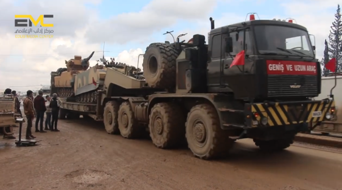 Turkish army truck carrying two APCs near the village of Hazanu (north of Idlib) on their way to the Idlib rural area.