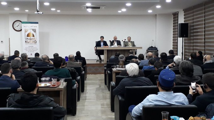 Isma'il Haniyeh, center on the podium, at the meeting. At the left is Jihad Yaghmour, Hamas' representative in Turkey (right picture, KUTAD Twitter account, February 26, 2020; left picture, Abdullah Ceylan's Twitter account, February 26, 2020).