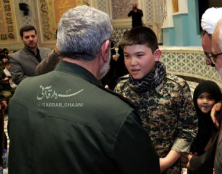 The commander of the Qods Force with the son of the commander of the Fatemiyoun Brigade, who was killed in Syria in 2015 (Telegram channel affiliated with Esmail Qa'ani, February 28, 2020)