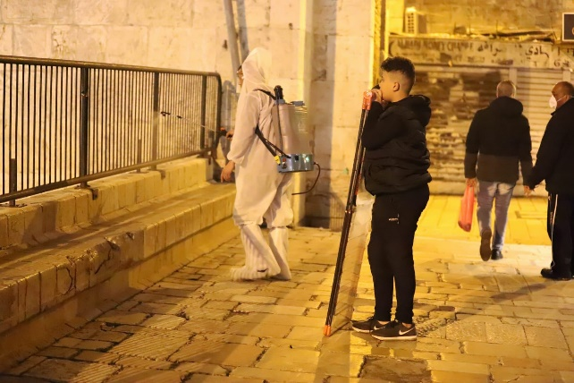 Sanitizing public places in the Old City of Jerusalem as instructed by Adnan Ghaith, the governor of the PA's Jerusalem district (Wafa, March 16, 2020).