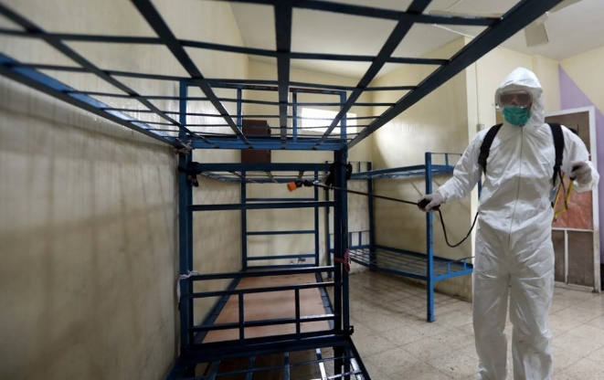 The Gazan police force sanitizes its facilities (al-Ra'i Agency, established by the Hamas de facto administration, March 12, 2020).