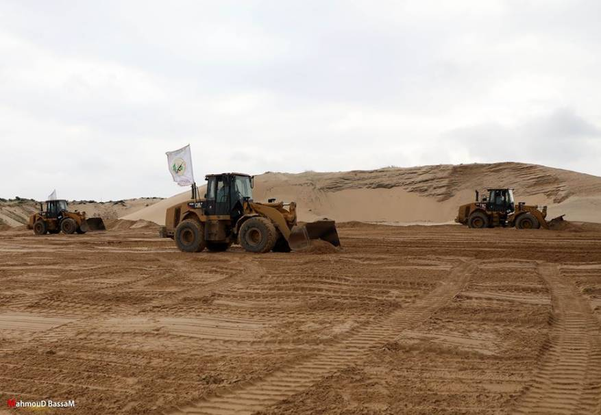 Tractors flying Izz al-Din Qassam Brigades flags participate in leveling the ground (Shehab, March 17, 2020).