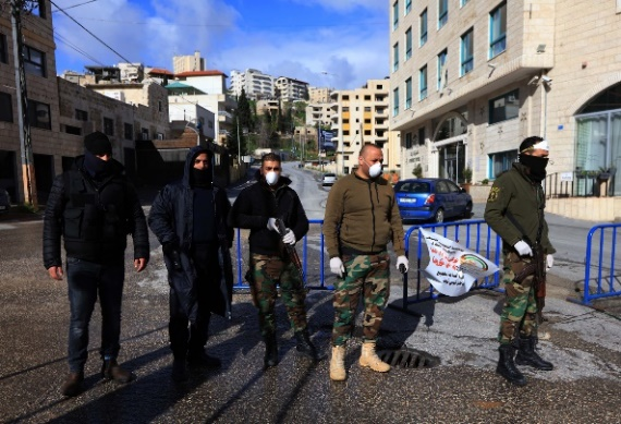 The PA security forces at the entrance to Bayt Sahour (Wafa, March 18, 2020).