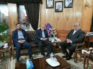 The Iranian Ambassador to Baghdad (center) and the Iranian military attaché (left) in a meeting with the governor of Kermanshah province (right) (IRNA, March 22, 2020)