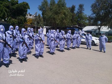 Force in charge of maintaining order in the northern Gaza Strip, which has been assigned to transfer people in quarantine (Facebook page of the Northern Gaza District Emergency Committee, March 29, 2020)