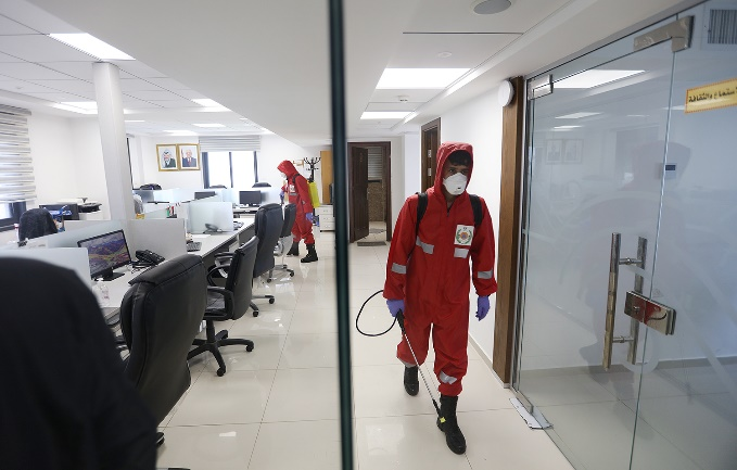 Disinfecting media offices in Ramallah, including the offices of the Wafa news agency (Wafa, April 2, 2020).
