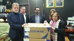 The health minister announcing the transfer of the swabs to the Gaza Strip (Facebook page of the Palestinian Authority Health Ministry, April 1, 2020)