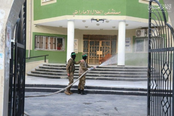 Hamas military wing operatives disinfect public facilities in the Gaza Strip (Filastin al-A'an, March 24, 2020).