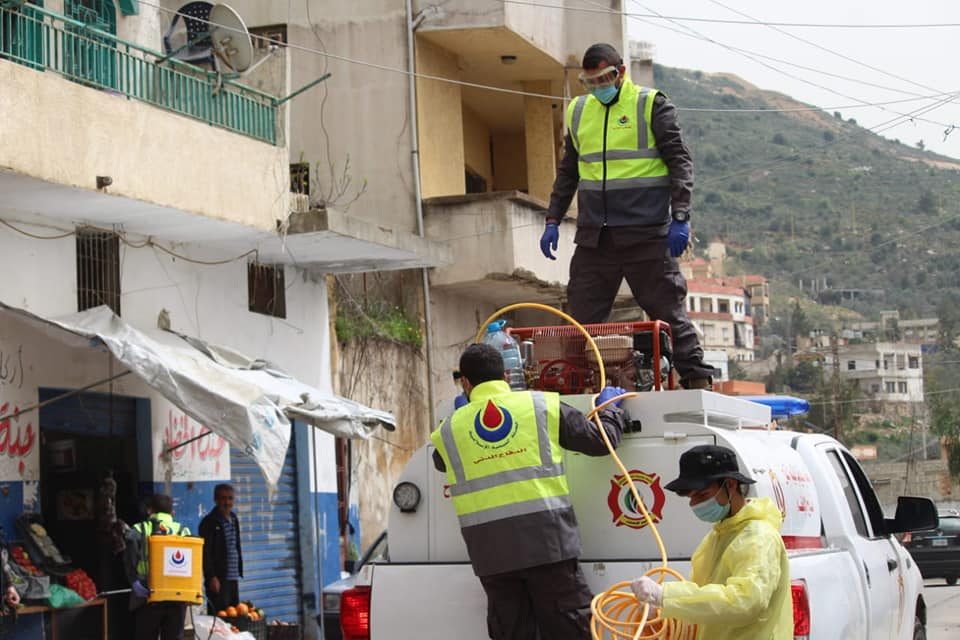Joint disinfection campaign of the Islamic Health Organization and the Iqlim al-Tuffah Union of Municipalities in Ein Qana, southern Lebanon (Rassed Network's Facebook page, March 27, 2020)