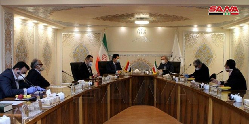 The meeting between the Syrian ambassador to Tehran and the chairman of the Iranian Supreme Council on Free Trade Zones (SANA, April 14, 2020)