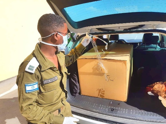 Sending the PCR device to the Gaza Strip via the Office of the Coordinator of Government Activities in the Territories (COGAT's Facebook page, April 12, 2020).