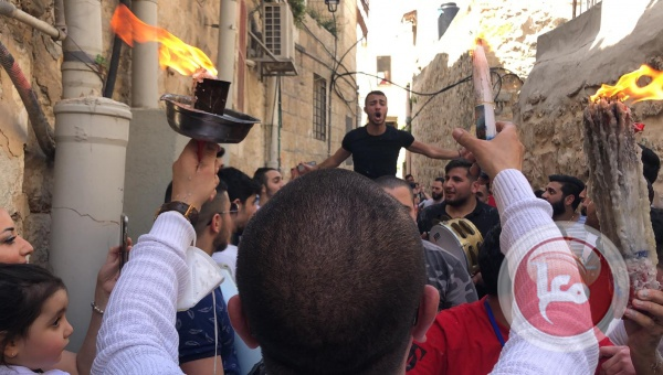Christians celebrate the Holy Fire in the Christian Quarter of the Old City, gathering in violation of the procedures instituted by the Israeli ministry of health (Ma'an, April 18, 2020).