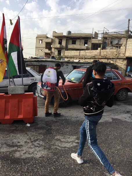 Taking temperatures at a Fatah checkpoint at the entrance to the Mieh Mieh refugee camp (Ahfad news network, March 23, 2020)