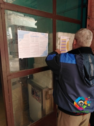 Hanging posters on coping with COVID-19 as part of an awareness campaign led by the PIJ in the Burj el-Shemali camp (website of the El-Buss refugee camp, March 25, 2020).