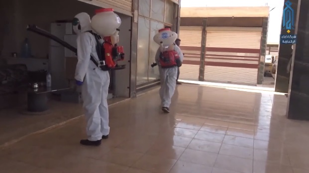 Staff of a humanitarian organization carrying out disinfection activity (Ibaa, April 19, 2020)