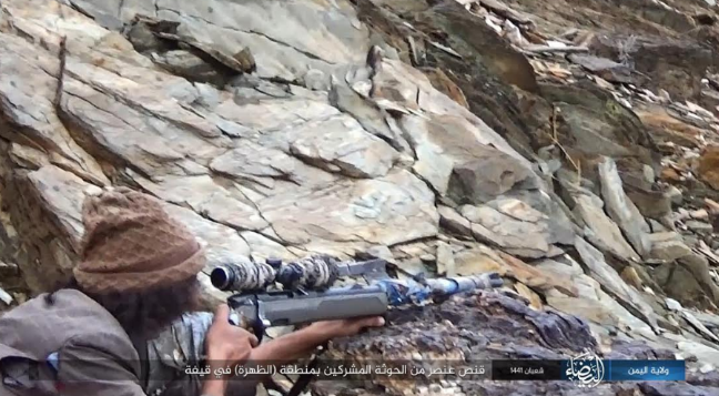 ISIS sniper firing at Houthi fighter.
