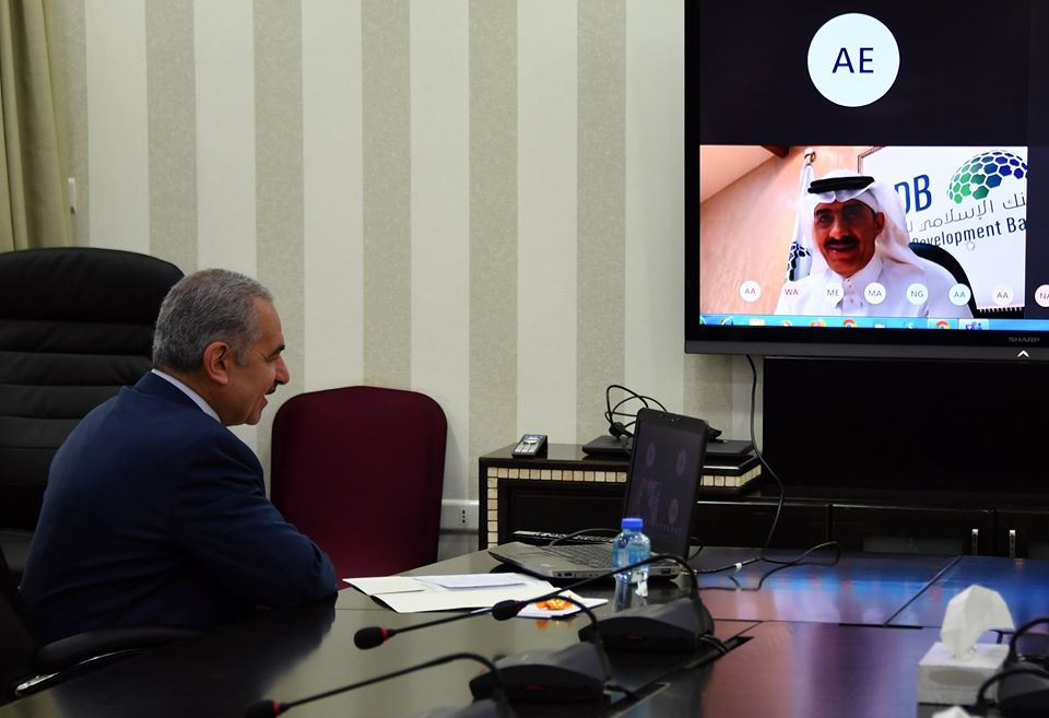 PA Prime Minister Muhammad Shtayyeh holds a video chat with the chairman of the Islamic Development Bank in Saudi Arabia (Facebook page of Muhammad Shtayyeh, April 19, 2020).