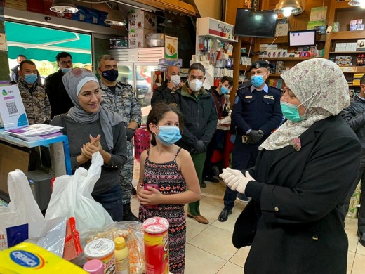 Laila Ghannam, the governor of the Ramallah district, visits markets
