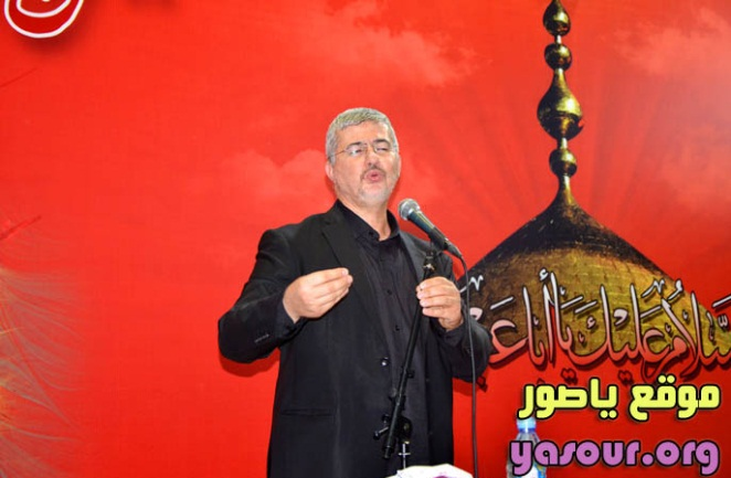 This is apparently Jawad Nur al-Din, the director general of the Martyrs Foundation, delivering a speech to families of Hezbollah shaheeds in the city of Tyre during an Ashura day ceremony.