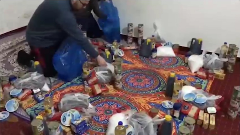 "The aid distributed by the office of the Nujaba Movement in the Gaza Strip. The aid package was accompanied by a leaflet with the emblem of the movement and a text reading, ""A present for the month of Ramadan from the Nujaba Movement to the families of shaheeds and prisoners in Palestine"" (website of the Nujaba Movement's information and public relations center in Iran, May 4, 2020)"
