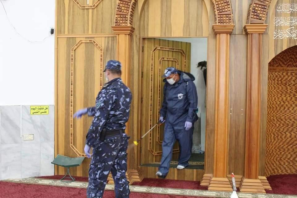 Palestinian security forces help disinfect the mosques in Jericho in preparation for their reopening (Fatah Facebook page, May 25, 2020).