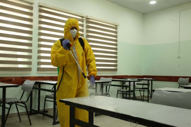 Disinfecting schools in Hebron in preparation for holding matriculation exams (Wafa, May 27, 2020).