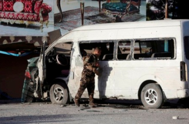 Afghan security guard near the bus against which the IED was activated (Afghanistan Times, May 30, 2020)