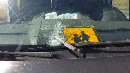 The damage done to the front windshield of the vehicle by the knife (Jordan Valley security, June 9, 2020).