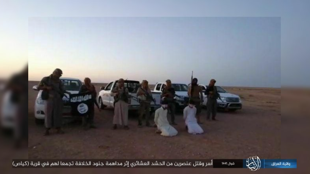 Armed ISIS operatives behind two Tribal Mobilization operatives before executing them west of Hit.