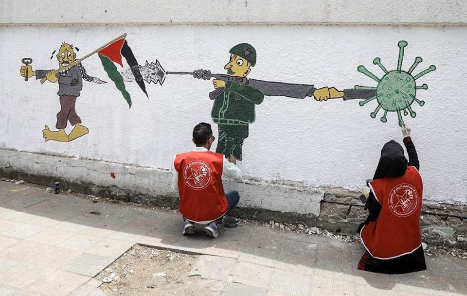 Wall painting in Gaza shows Israel shooting a cloud of the coronavirus at a Palestinian (Twitter account of YouthGoDigital, June 8, 2020).