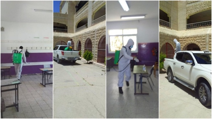 Teams of workers sent by the Dhahariya municipality disinfect rooms in school buildings where matriculation exams will be held (Facebook page of the Dhahariya municipality, June 11, 2020)