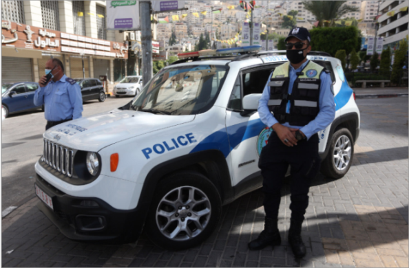 The Palestinian police in Nablus implement the lockdown on the city (Wafa, June 21, 2020).