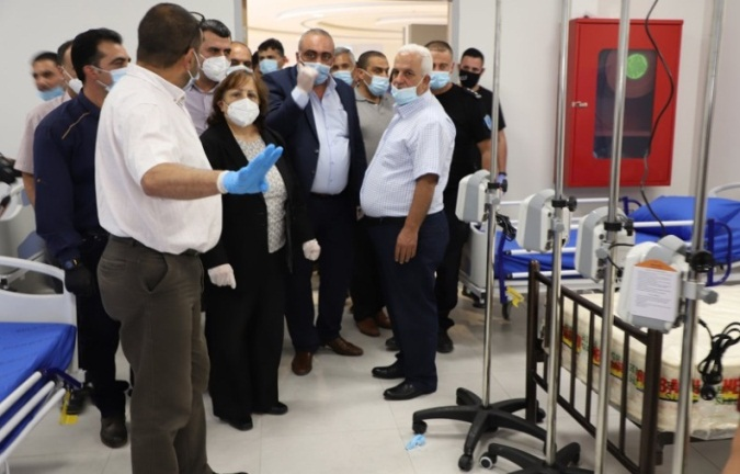 The Palestinian minister of health visits the government hospital in Dura which was turned into a medical center for treating COVID-19 patients (Facebook page of the PA ministry of health, June 24, 2020).