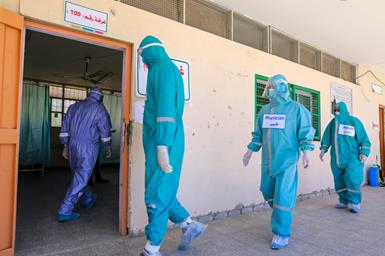 Medical staff during a simulation drill, apparently in Khan Yunis (W.H.O. website, June 25, 2020).