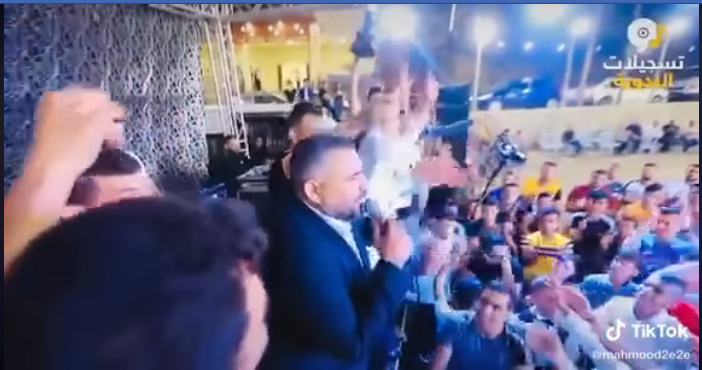 "Photo from the wedding video posted by Jenin District Governor Akram al-Rajoub on his Facebook page addressing the wedding singer: ""Hafez! When you break the law, the PA arrests you […] Yesterday we made do with detaining you for eight hours, and were it not for our love and respect for [you] Musa Al-Hafez, we would prosecute you"" (Akram al-Rajoub's personal Facebook page, July 3, 2020)"
