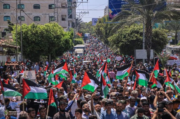 Palestinian flags waved at a