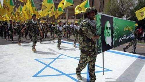 "Operatives of Kataeb Hezbollah carrying the photo of Ayatollah Khomeini in a military parade on ""World Jerusalem Day"" (Iraqi News Agency, November 13, 2018)"