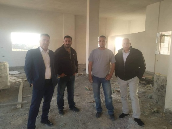 Abd al-Satar Awad (right), the secretary of the Fatah branch in Salfit, visits the house under construction in the village of al-Zawiya for the family of terrorist Omar Abu Layla (Facebook page of the branch of Fatah in al-Zawiya, July 7, 2020).