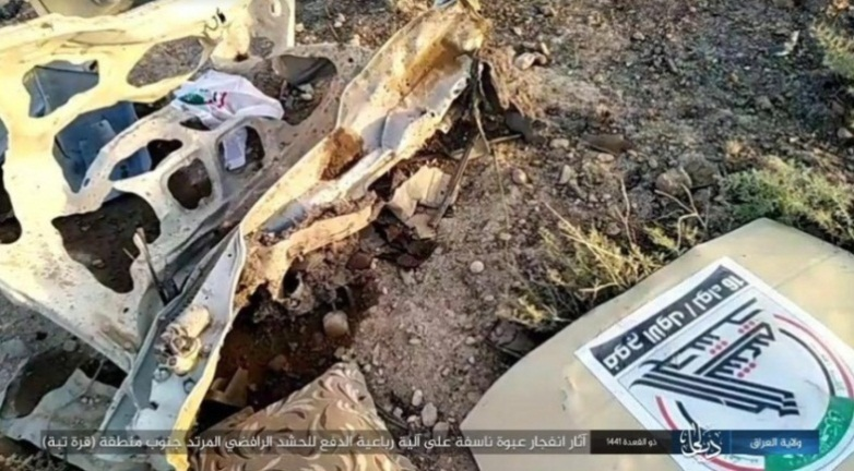 "Wreckage of the Popular Mobilization vehicle destroyed by an ISIS IED (Telegram, July 14, 2020). The Popular Mobilization emblem is visible on it""."