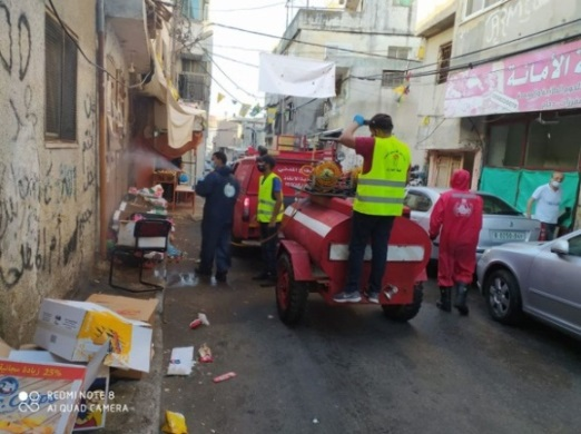 Disinfecting the al-Om'ari refugee camp (Palestinian civil defense Facebook page, July 18, 2020).