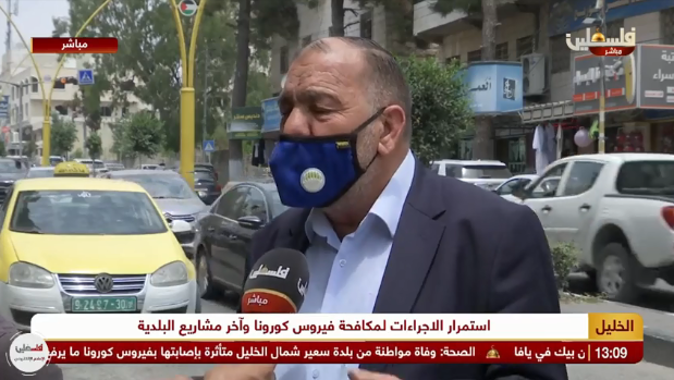 Taysir Abu Sneina, Hebron mayor, warns local residents to follow government instructions during the Eid al-Adha holiday (Palestinian TV Facebook page, July 27, 2020).