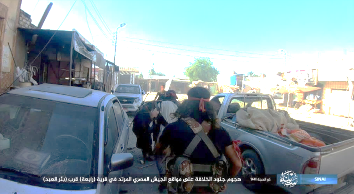 ISIS operatives on their way to attack an Egyptian army camp and positions in the village of Rabi'a.