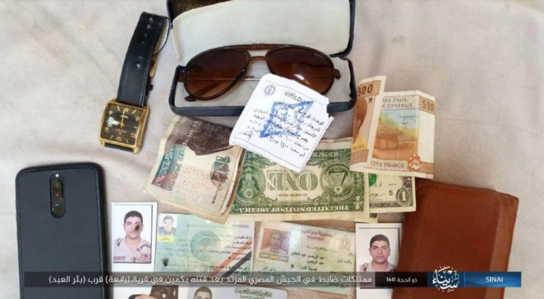 IDs, a smartphone and cash that were in the possession of the Egyptian officer who was executed (Telegram, July 28, 2020)