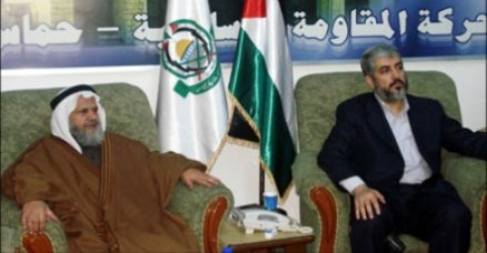Khaled Mashaal (right) at the Arab Parties' conference: