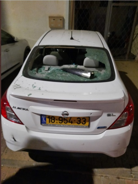 The vehicle damaged by fragments of the intercepted rocket (Twitter account of Almog Boker, August 2, 2020).