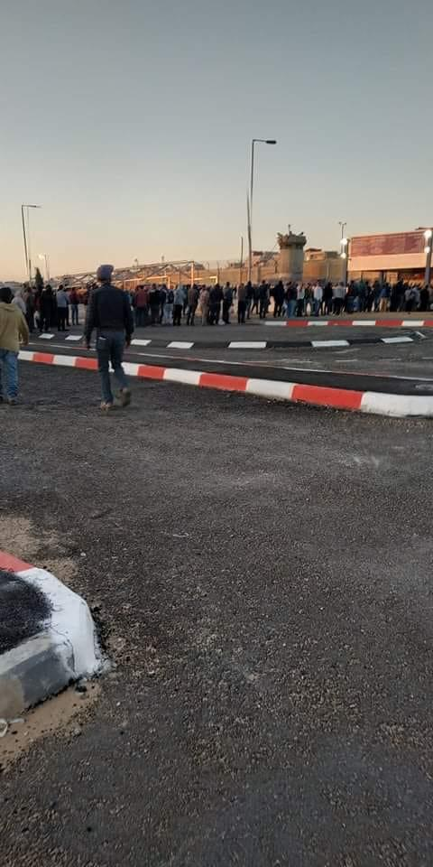 Residents of Kafr 'Aqab wait for social security payments at the Qalandia Crossing. In both pictures the local inhabitants can be seen not wearing masks or practicing social distancing (pictures courtesy of the Jerusalem municipality).