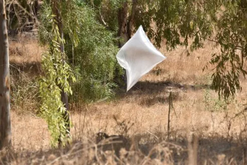 Neutralizing incendiary balloons found in a farm in the western Negev (Israel Police Force spokesman's unit, August 18, 2020).